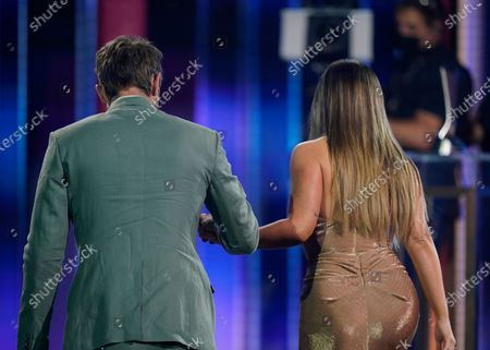 """Ryan Hurd, left, walks Maren Morris to the stage to accept the award for song of the year for """"The Bones"""" at the 56th annual Academy of Country Music Awards, at the Grand Ole Opry in Nashville, Tenn"""