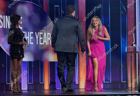 """Martina McBride, from left, presents Lee Brice and Carly Pearce with the award for single of the year for """"I Hope You're Happy Now""""at the 56th annual Academy of Country Music Awards, at the Grand Ole Opry in Nashville, Tenn"""