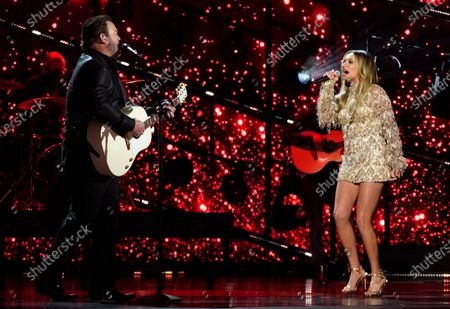 Stock Image of Lee Brice, left, and Carly Pearce perform at the 56th annual Academy of Country Music Awards, at the Grand Ole Opry in Nashville, Tenn