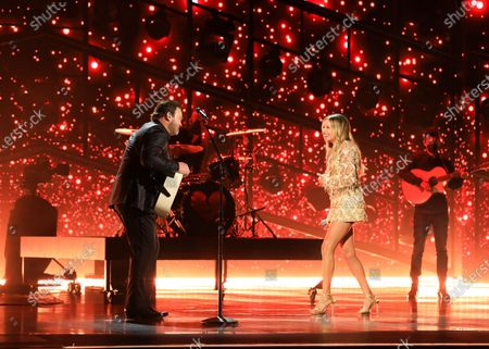 Carly Pearce and Lee Brice perform