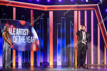 Stock Picture of Thomas Rhett wins the award for Male Artist of the Year