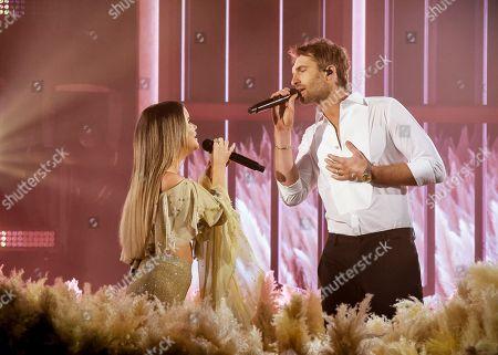 Stock Photo of Maren Morris and Ryan Hurd perform