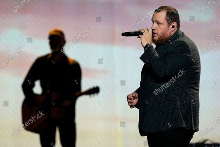 Luke Combs performs at the 56th annual Academy of Country Music Awards, at the Grand Ole Opry in Nashville, Tenn. The awards show airs on April 18 with both live and prerecorded segments