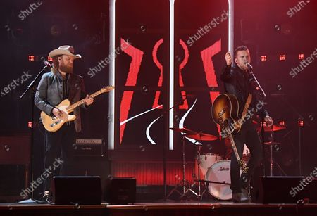 Stock Picture of John Osborne, left, and T.J. Osborne, of Brothers Osborne, perform at the 56th annual Academy of Country Music Awards, at the Ryman Auditorium in Nashville, Tenn
