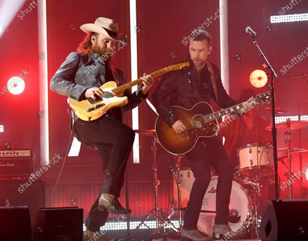 John Osborne, left, and T.J. Osborne, of Brothers Osborne, perform at the 56th annual Academy of Country Music Awards, at the Ryman Auditorium in Nashville, Tenn