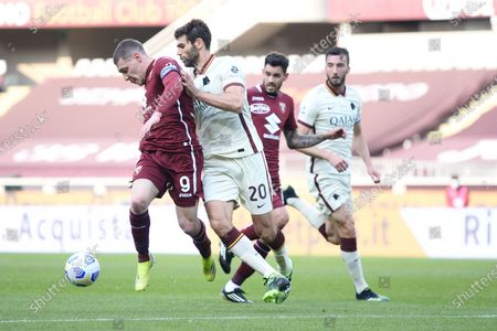 Andrea Belotti of Torino FC  and Federico Fazio of AS Roma during the Serie A football match between Torino FC and AS Roma. Sporting stadiums around Italy remain under strict restrictions due to the Coronavirus Pandemic as Government social distancing laws prohibit fans inside venues resulting in games being played behind closed doors. Torino FC won 3-1 over AS Roma