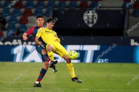 Levante's defender Oscar Duarte (L) and Villarreal's Gerard Moreno    during spanish La Liga match between Levante UD  and  Villarreal CF  at Ciutat de Valencia  Stadium in Valencia, Spain on April 18, 2021.