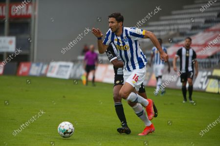 Stock Photo of Marko Grujic of FC Porto controls the ball during the Liga Nos match between CD Nacional and FC Porto at Estádio da Madeira on April 18, 2021 in Funchal, Madeira, Portugal.