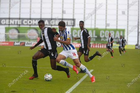 Stock Picture of Marko Grujic of FC Porto battle for the ball with Pedrão of CD Nacional during the Liga Nos match between CD Nacional and FC Porto at Estádio da Madeira on April 18, 2021 in Funchal, Madeira, Portugal.