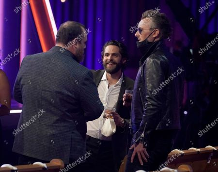 Luke Combs, from left, Thomas Rhett and Eric Church speak in the audience at the 56th annual Academy of Country Music Awards, at the Grand Ole Opry in Nashville, Tenn