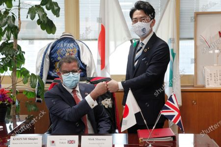 President for COP26 Alok Sharma, left, meets with Japanese Environment Minister Shinjiro Koizumi at the latter's ministry in Tokyo