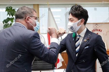 President for COP26 Alok Sharma, left, greets Japanese Environment Minister Shinjiro Koizumi at the latter's ministry in Tokyo