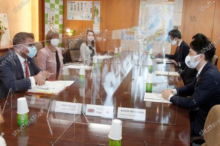 President for COP26 Alok Sharma, left, talks with Japanese Environment Minister Shinjiro Koizumi, right, at the latter's ministry in Tokyo