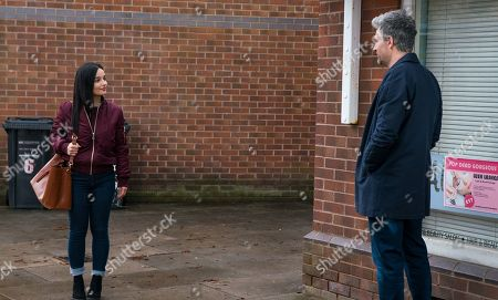 Stock Image of Coronation Street - Ep 10303 Monday 19th April 2021 - 1st Ep Emma Brooker clocks Lucas, as played by Glen Wallace, flirting with Alina Pop, as played by Ruxandra Porojnicu, outside the salon and urges her to go for it.