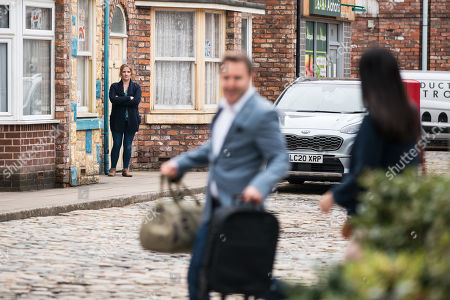 Coronation Street - Ep 10306 Wednesday 21st April 2021 - 2nd Ep Maria Connor calls at No.9, but Fiz gives her short shrift and as Fiz Stape, as played by Jennie McAlpine, goes to close the door, she spots Tyrone Dobbs, as played by Alan Halsall, and Alina Pop, as played by Ruxandra Porojnicu, clearly loved up.