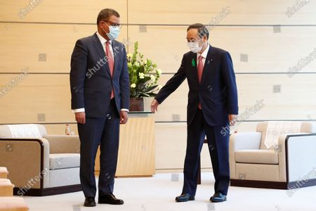 President Alok Sharma, left, and Japan's Prime Minister Yoshihide Suga meet at the prime minister's official residence in Tokyo