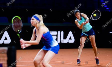 Stock Photo of Raluca Olaru of Romania & Nadiia Kichenok of the Ukraine in action during the doubles semi-final of the 2021 Porsche Tennis Grand Prix WTA 500 tournament
