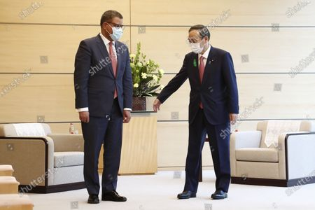 (L-R) COP26 President Alok Sharma and Japan's Prime Minister Yoshihide Suga meet at the Prime minister's official residence in Tokyo, Japan, 19 April 2021. The 2021 United Nations Climate Change Conference, also known as COP26, is scheduled to be held in the city of Glasgow from 01 to 12 November 2021.