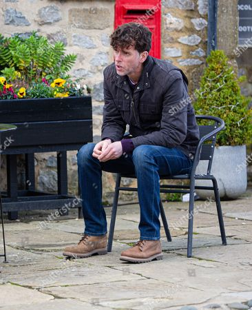 Stock Image of Emmerdale - Ep 9028 Thursday 22nd April 2021 Marlon Dingle, as played by Mark Charnock, frets about the Woolpack's financial struggles.