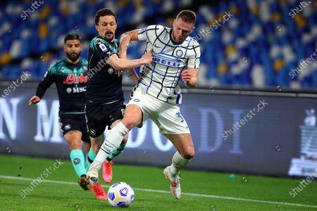 Mario Rui of Napoli (L) vies for the ball with Milan Skriniar of Internazionale (R)