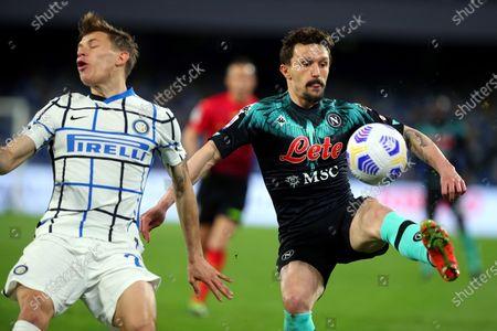 Mario Rui of Napoli (R) vies for the ball with Nicolo' Barella of Internazionale