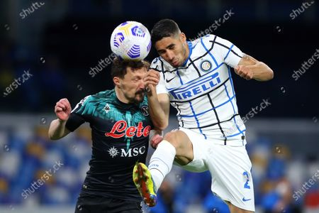 Mario Rui of Napoli (L) goes for a header with Achraf Hakimi of Internazionale (R)
