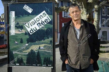 Stock Image of France's author, screenwriter and film director Emmanuel Carrere poses for the photographer during the documentary film festival Visions du Reel (Visions of Reality) in Nyon, Switzerland, 19 April 2021.