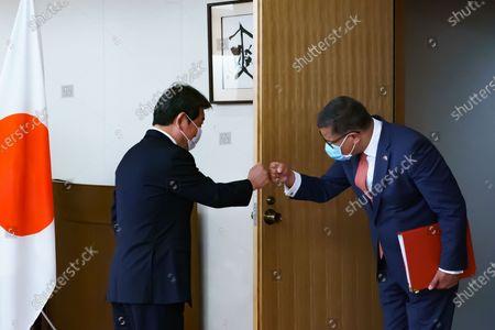 COP 26 President Alok Sharma and Japan's Foreign Minister Toshimitsu Motegi