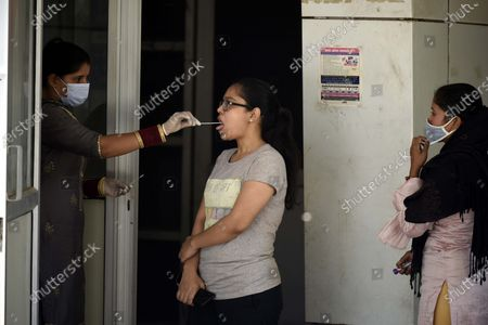 A woman gives a swab sample for Covid-19 test at Old Civil Hospital near MCG office, on April 18, 2021 in Gurugram, India.