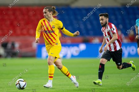Antoine Griezmann of Barcelona and Unai Lopez of Athletic Club