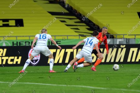 Stock Picture of Midfielder Marlos (R) of FC Shakhtar Donetsk attempts to get past midfielder Carlos de Pena (C) and defender Vitaliy Mykolenko (L) of FC Dynamo Kyiv during the Ukrainian Premier League Matchday 22 game at the NSC Olimpiyskiy, Kyiv, capital of Ukraine.