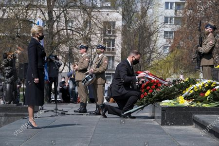 Polish President Andrzej Duda (2R) with wife Agata Kornhauser-Duda (L) during the official ceremony marking the 78th anniversary of the Warsaw Ghetto Uprising at the Monument to the Ghetto Heroes in Warsaw, Poland, 19 April 2021. The 1943 Warsaw Ghetto Uprising against the Nazis was the largest single act of Jewish resistance against the Nazis during World War II.