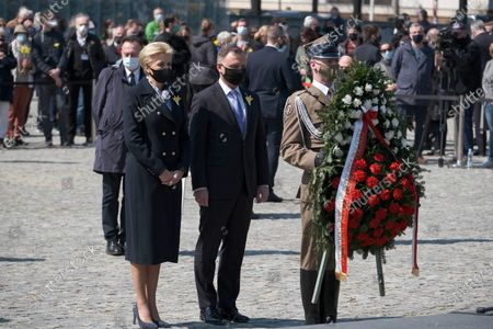 Stock Photo of Polish President Andrzej Duda (C) with wife Agata Kornhauser-Duda (L) during the official ceremony marking the 78th anniversary of the Warsaw Ghetto Uprising at the Monument to the Ghetto Heroes in Warsaw, Poland, 19 April 2021. The 1943 Warsaw Ghetto Uprising against the Nazis was the largest single act of Jewish resistance against the Nazis during World War II.