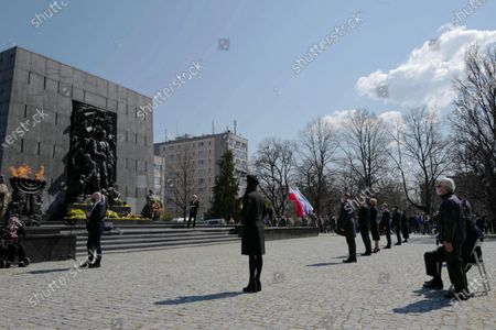 Polish President Andrzej Duda (3L) with wife Agata Kornhauser-Duda (4L) during the official ceremony marking the 78th anniversary of the Warsaw Ghetto Uprising at the Monument to the Ghetto Heroes in Warsaw, Poland, 19 April 2021. The 1943 Warsaw Ghetto Uprising against the Nazis was the largest single act of Jewish resistance against the Nazis during World War II.