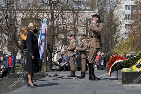 Stock Image of Polish President Andrzej Duda (2L) with wife Agata Kornhauser-Duda (L) during the official ceremony marking the 78th anniversary of the Warsaw Ghetto Uprising at the Monument to the Ghetto Heroes in Warsaw, Poland, 19 April 2021. The 1943 Warsaw Ghetto Uprising against the Nazis was the largest single act of Jewish resistance against the Nazis during World War II.