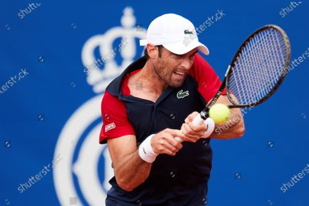 Spanish tennis player Pablo Andujar in action against French Gilles Simon during the first round match of the Barcelona Open Banc Sabadell Conde Godo Tennis tournament, an ATP World Tour 500 category, played at Tennis Royal Court of Barcelona, Spain, 19 April 2021.