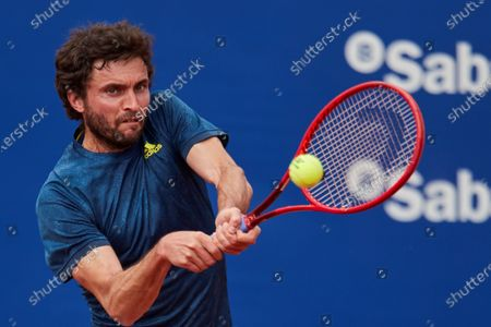 Stock Photo of French tennis player Gilles Simon in action against Spanish Pablo Andujar during the first round match of the Barcelona Open Banc Sabadell Conde Godo Tennis tournament, an ATP World Tour 500 category, played at Tennis Royal Court of Barcelona, Spain, 19 April 2021.