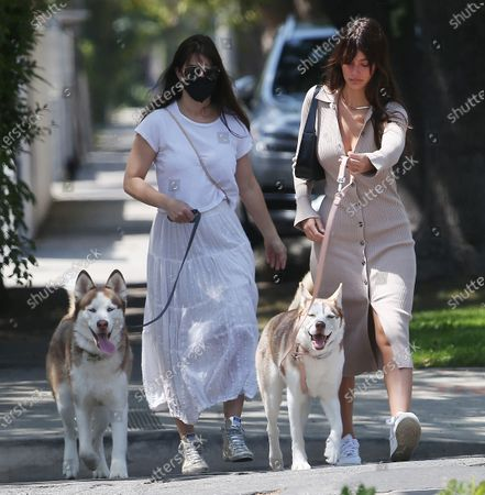 Camila Morrone walking her dogs with her mother