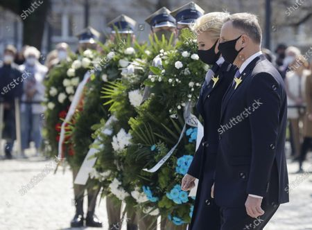 Stock Picture of Poland's President Andrzej Duda, right, and First Lady Agata Kornhauser-Duda, second right, during wreath-laying ceremony at the Monument to the Ghetto Heroes to honor the fighters of the 1943 Warsaw Ghetto Uprising against the German Nazi troops, on the 78th anniversary of the ill-fated struggle, in Warsaw, Poland