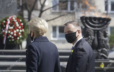 Poland's President Andrzej Duda, right, and First Lady Agata Kornhauser-Duda, left, during wreath-laying ceremony at the Monument to the Ghetto Heroes to honor the fighters of the 1943 Warsaw Ghetto Uprising against the German Nazi troops, on the 78th anniversary of the ill-fated struggle, in Warsaw, Poland