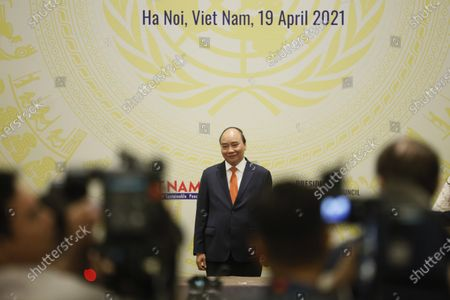Vietnamese newly-elected President Nguyen Xuan Phuc arrives for the virtual meeting on 'Cooperation between the United Nations and regional organizations in enhancing confidence-building and dialogue in conflict prevention and resolution', in Hanoi, Vietnam, 19 April 2021.