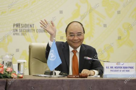 Vietnamese newly-elected President Nguyen Xuan Phuc smiles as he addresses the virtual meeting on 'Cooperation between the United Nations and regional organizations in enhancing confidence-building and dialogue in conflict prevention and resolution', in Hanoi, Vietnam, 19 April 2021.