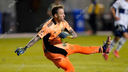 Portland Timbers goalkeeper Steve Clark clears the ball in the second half during an MLS soccer game against the Vancouver Whitecaps, in Sandy, Utah