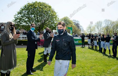 Champion jockey Harry Skelton walks through a guard of honourSandown 24..4.21 Pic: Edward Whitaker