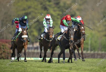 Enrilo (Harry Skelton,2nd right) beats Potterman (3rd right) and Kitty's Light (right) in the bet365 Gold Cup Chase pending a stewards enquiry Sandown 24..4.21 Pic: Edward Whitaker