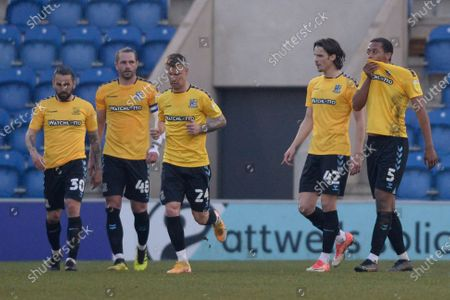 (L-R) Ricky Holmes, John White, Jason Demetriou, Sam Hart and Shaun Hobson of Southend United react after Harry Pell of Colchester United Scores their sides second goal during Sky Bet League Two match between Colchester United and Southend United at JobServe Community Stadium in Colchester - 20th April 2021