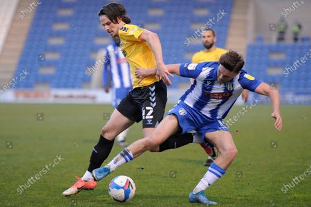 Noah Chilvers of Colchester United and  Sam Hart of Southend United in action during Sky Bet League Two match between Colchester United and Southend United at JobServe Community Stadium in Colchester - 20th April 2021
