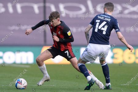 Scott Malone of Millwall and David Brooks of AFC Bournemouth in action during the Sky Bet Championship, Championship match between Millwall and AFC Bournemouth at The Den in London - 21st April 2021