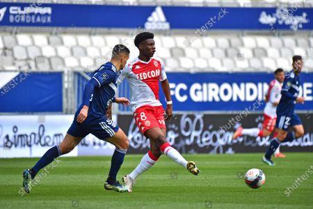 Stock Photo of Aurelien Tchouameni AS Monaco ahead of Hatem Ben Arfa Bordeaux