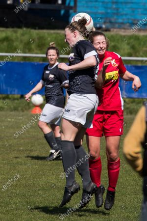Carys Davies (2 Port Talbot) and Amy Williams (7 Abergavenny) jump for a header during the Welsh Premier Womens Football League game between Port Talbot and Abergavenny at Victoria Road in Port Talbot, Wales.
